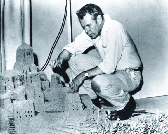 Jerome Hill with a model of the titular castle. (Source)